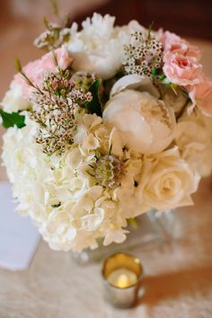 White peony + hydrangea + blush rose centerpiece by Designs by Darin