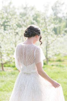 Delicate beaded gown: http://www.stylemepretty.com/2015/07/23/romantic-wedding-inspiration-at-hickory-hill-orchard/ | Photography: Simply K Studios - http://www.simplykstudios.com/