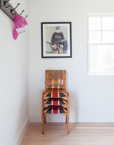 Wooden Union Jack chairs below a framed photograph