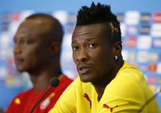 Ghana national football team captain Asamoah Gyan (R), has been accused of sacrificing the body of his friend, local rapper Castro.
