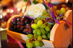 Delicious grapes adorn the table alongside cheese, bread and of course wine for a Tuscan themed wedding.