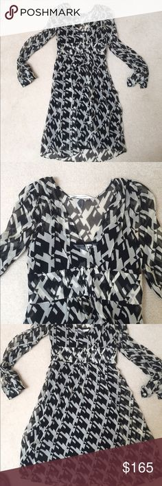 DVF Silk Dress DVF geometric silk long sleeve dress. Fits tts. Side zip. A few very small unnoticeable pills and a small stain shown in the photo. Make an offer! Diane Von Furstenberg Dresses