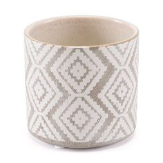 They love this beautifully Bohemian graphic design on a textured organic surface. It's the perfect size and shape for an assortment of succulents. Place it on an accent table in a living room, bedroom or entryway for a laid back vibe.