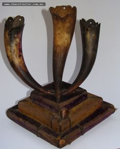 Lot 362 - 1930's 3 small buffalo horns mounted on purple and yellow velvet covered base - ( The Royal Anterdiluvian Order of The Buffaloes presentation piece)