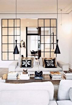 Fun living room with hanging pendants | black pillows on white couch