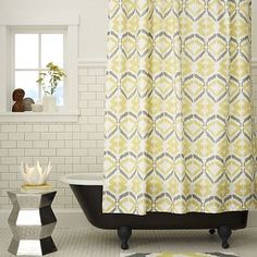 I love the Tali Printed Shower Curtain on westelm.com We really want a yellow and gray guest bath!