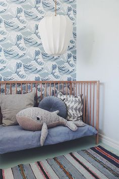 how darling is this little boys room or a play room for kids? Coastal waves wallpaper, whale pillow