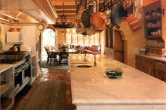 WOW! Love this! Large, rustic kitchen design in the Country French manor style. Discovered on www.Porch.com