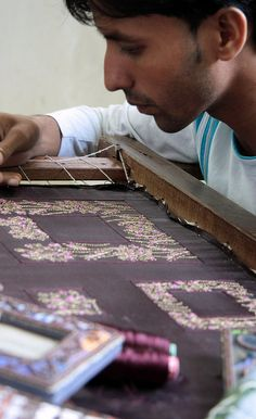 Intricate art and practice of hand embroidery. Colorful India.