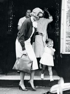 Grace Kelly, princess of Monaco, carrying an Hermès Kelly bag in 1958. The purse had originally been called the Hermès Petite Sac pour Dame,...