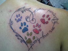 Done on my birthday, each of my 5 babies paws stamped in ink and put into this tattoo, I love how my artist made the left side of the heart.