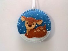 Baby reindeer ornament / Felt Christmas ornament / wool blend felt/ blue background  This listing is for 1 ornament - blue background - baby reindeer - embroidered white snowflakes  Size about 8 cm Material wool blend felt  Handmade from felt with high precision and great care  Please note that ornaments are decorated on one side only. Other side is solid blue.  For more Christmas ornaments visit my Christmas section https://www.etsy.com/shop/DusiCrafts?section_id=15537694…
