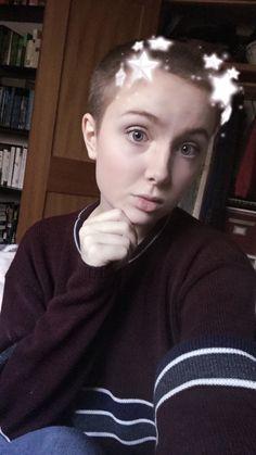 A girl with such a cute buzz cut