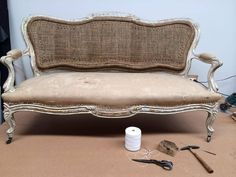 Antique sofa in its base cloth/foundation state reupholstered to look exactly as it was.
