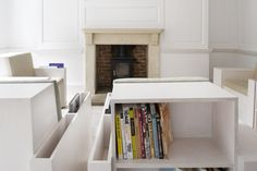Living in a shoebox | Armchair with built-in library