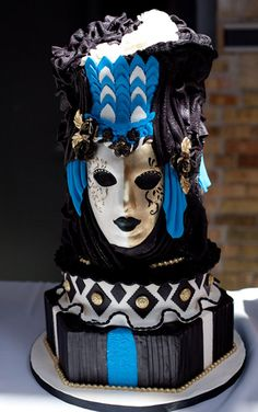 This Venetian mask-inspired design is a must-have for any Mardi Gras themed wedding. Its bold colours and stunning features make it more of a show piece than just dessert.--Cake by Tracey Torti.