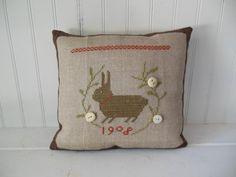 Completed Cross Stitch Primitive Bunny Pillow With Vintage Buttons, Cross Stitch Design by  With Thy Needle & Thread.