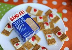 Ghram crackers, frosting, or cream cheese,(whatever you want to use) gel decorating frosting. _----------------------------------BAND-AIDS YUM!