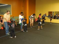 Parent participation in kids Kung fu class.