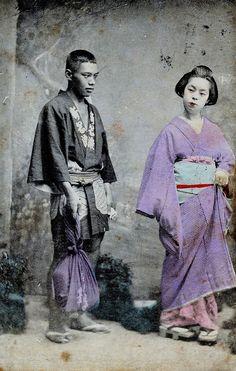 Geisha and servant, 1900. This man could possible be a hakoya, a man who carried geisha's shamisen.