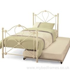 Single ivory finished metal bed frame with extra underneath rollaway guest bed.