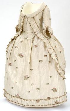 This Polonaise gown or 'robe à la Polonaise' dates from between 1780-1781. It is made of cream brocaded silk woven with clusters of flowers in pinks and greens. It was worn by Mary Mcdowell, daughter of William Mcdowall of Castle Semple. In 1779 Mary married George Houston of Johnstone Castle, a local landowner and textile industrialist who founded textile mills on the Black Cart Water and accompanying town for his workers in 1782.