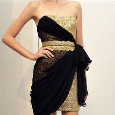 Black and gold. Something intrigues me about this, but I'm not sure I'm 100% sold.... Hmm...