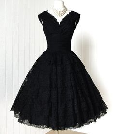 1950's Francine Cleveland, Ohio, black scalloped lace party dress.  Classic silhouette with a fitted bodice and full, swingy skirt, flattering ruched waist, sexy plunging neckline and back, black lace backed with black tulle, black ruffled tulle crinoline, and a black underskirt.