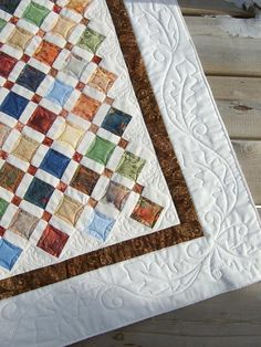 Oak leaf border is very well done!  Love how the curved quilting in the square softens the block.