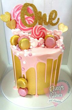 Pink and gold. Lollipops. First birthday choc drip cake
