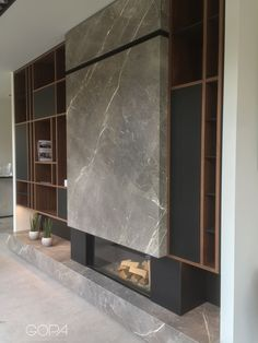 Walnut wall, Nano Tech cabinets and metal shelves where the Fior Di Bosco is a show stopper. Home Fireplace, Fireplace Remodel, Modern Fireplace, Living Room With Fireplace, Fireplace Design, Living Room Decor, Fireplaces, Home Room Design, Interior Design Living Room