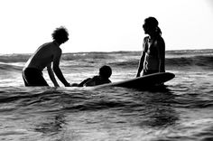 Family time on the surfboard...love it!
