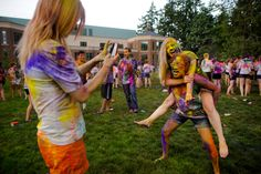 Students enjoy the myriad photo opportunities that the Holi celebration provided, which featured face painting and clouds of multicolored flour thrown amidst the crowd. Holi Celebration, Crowd, Oregon, Emerald, Students, Celebrities, Face, Painting, Celebs