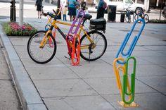 Risultati immagini per bike racks public Street Furniture, Metal Furniture, Distressed Furniture, Sidewalk Art, Bike Parking, Bike Rack, Cool Inventions, Outdoor Art, Public Art