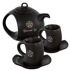 "Our AWESOME Blessed Be Pentacle Tea Sets are back in stock Eclectic Artisans! Ech set comes with the Tea Kettle (with a carved pentacle and Blessed Be Saying), 2 matching pentacle tea cups, and 2 matching saucers (both have ""blessed be"" and a carved pentacle on them as well). A great time to start Holiday Shopping...WE'RE DOING FREE DOMESTIC SHIPPING FOR $75+ Orders and $5 Flat Rate Shipping for everything else until November 1st!"