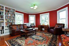 Traditional Living Room with Hardwood floors, Built-in bookshelf, Area rug, Safavieh Austin AUS1580-4070 Red - Navy Area Rug