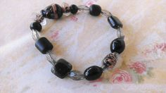 Variation Black And Clear Glass Bead Bracelet by amyrigs on Etsy