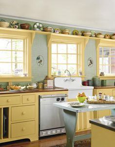A Cheery Kitchen-A Cheery Kitchen    The kitchen gets its farmhouse warmth from cherry counters, an antique island, gingham-check wallpaper, and an apron sink.      Read more: Floral Home Decor - Flower Print Decor for Home - Country Living
