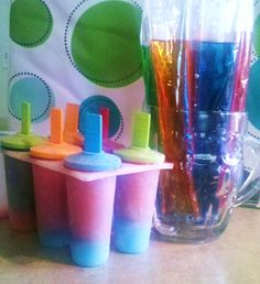 Awesome layered ice pops:  buy the freeze-pops from a local store, don't freeze, but cut open and pour between different popscicles. Freeze the first layer then cut open another color and pour on that one, adding the stick and freezing.  Easier than making an entire pitcher of Kool-aid. My kids get tired of the same flavor every day for a week!