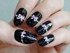 Ida-Marian kynnet / Black polish with bows / #Nails #Nailart