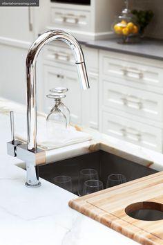 Prep sink surrounded by Calcutta Borghini Marble counters   Liz Williams Interiors via Atlanta Homes & Lifestyles