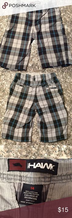 Boys Hawk plaid shorts Boys Sz 14 plaid shorts. Front slit pockets and back pockets that Velcro and smaller slit pocket. Color is light gray, charcoal black, black and turquoise blue stripes. . Great condition - like new! Tony Hawk Bottoms Shorts