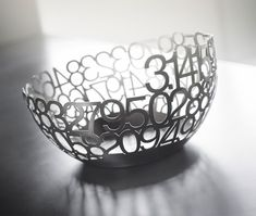 The Pi bowl is laser cut from 18/8 stainless steel to 80 digits using 3D laser cutting technology in a production facility just outside Toronto, Canada. The Pi collection also includes baskets, vases and wine coasters.www.steelforme.com