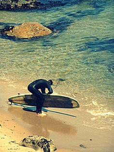 Surfer on west side Santa Cruz Ca