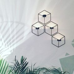 Wall decor inspiration courtesy of & Combine multiple Menu POV candle holders to create a beautiful geometric installation. The nature of the design results in a playful interaction with the object from multiple angles.