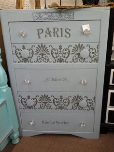 SOLD - This vintage Thomasville dresser has 5 drawers and is painted gray with Paris theme stencil. ***** In Booth C17 at Main Street Antique Mall 7260 E Main St (east of Power RD on MAIN STREET) Mesa Az 85207 **** Open 7 days a week 10:00AM-5:30PM **** Call for more information 480 924 1122 **** We Accept cash, debit, VISA, Mastercard, Discover or American Express