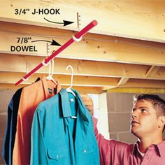 Attach J-hooks to joists.    If you need a clothes rod in the laundry room and you have exposed joists, check out this simple, solid and fast way to get it. Attach 3/4 in. J-hooks (these are typically used for hanging pipe) to the joists and snap a 7/8-in. dowel in the curve.