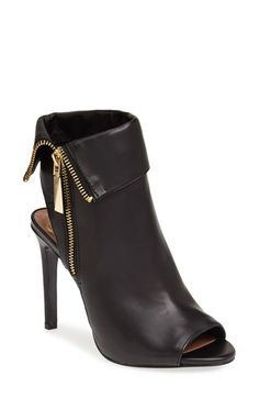 love the cutout heel on these peep toes (and now peep heels)