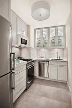 Love The Frosted Glass On The Cabinet Doors. From Apartment Therapy   Our  10 Favorite Small Kitchens. Home Decor And Interior Decorating Ideas.