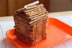 Easy log cabin to make using pretzels and peanut butter -- sure to be a President's Day favorite!